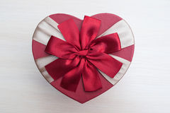 Holiday box in the shape of a heart with a bow, Valentine's Day Royalty Free Stock Image