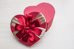 The holiday box in the shape of a heart with a bow on Valentine' Royalty Free Stock Image