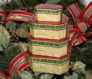 Holiday Boxes. Beautiful holiday boxes sitting on a wreath Royalty Free Stock Image