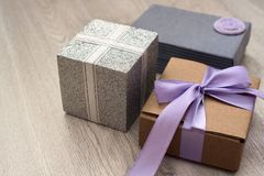 Holiday boxes with gifts on wooden background. royalty free stock photography