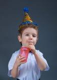 Holiday Boy drinking juice Stock Images