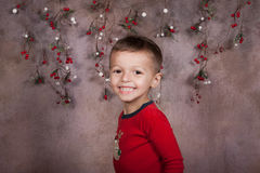 Holiday boy. Portrait of Happy little boy in red shirt smiling Royalty Free Stock Photos