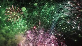 Holiday bright fireworks in sky stock video footage