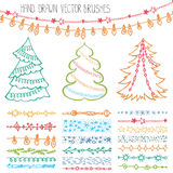Holiday  brushes.Christmas doodle set.Colored. Christmas Hand drawn  brushes,line border.New year doodle pattern textures,snowflakes, lamps, stars ornament Stock Photography