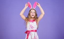 Holiday bunny girl with long bunny ears. Child cute bunny costume. Playful baby celebrate easter. Spring holiday. Happy. Childhood. Ready for Easter day. Easter royalty free stock photography