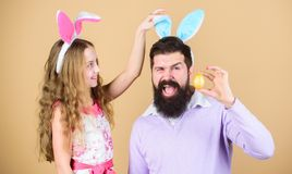 Holiday bunny long ears. Family tradition concept. Dad and daughter wear bunny ears. Father and child celebrate easter. Spring holiday. Easter spirit. Easter royalty free stock photos