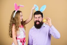 Holiday bunny long ears. Family tradition concept. Family dad and daughter wear bunny ears. Father and child celebrate. Easter. Spring holiday. Easter day royalty free stock images