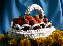 Holiday cake. A birthday cake in the form of the basket of peaches on a blue background and yellow flowers in the foreground Royalty Free Stock Photography