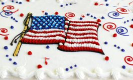 Holiday Cake. Cake with white frosting and flag and red,white and blue decorations Royalty Free Stock Images