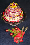 Holiday cake and Christmas tree twigs decorated with balls Royalty Free Stock Photography