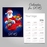 2016 holiday calendar with Santa and gifts. On a blue background Stock Photo