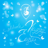 Holiday calligraphy, ballon egg and rabbit. Hand lettering greet. Ings Happy Easter on sky blue background Royalty Free Stock Photos