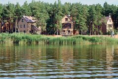 Nature, water, river ,summer,houses. Holiday camp in the forest near the river Royalty Free Stock Images