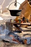 Holiday campfire. Medieval camp fire, cooking a good soup Royalty Free Stock Photos