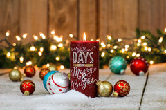 Holiday candle with Christmas decorations Royalty Free Stock Photo