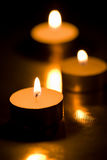 Holiday candles burning in the dark Stock Photos