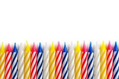 Holiday candles lined up in a row on a white background isolate Royalty Free Stock Photo