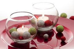 Holiday Candles. On a red decorative plate with accents Stock Photo