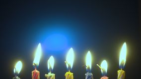 Holiday candles in a row. Over dark background stock footage