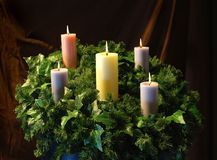 Holiday Candles and wreath. Holiday Candles and leaf wreath stock photos