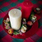 Holiday candles. In wreaths on tablecloth Royalty Free Stock Image