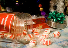 Holiday Candy. Spilling out of the jar onto a table Royalty Free Stock Photo