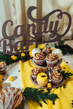 Holiday candy bar. Candy bar served with cupcakes with chocolate and lemon cream royalty free stock photography