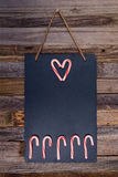 Holiday candy cane heart shape and fence Stock Photography