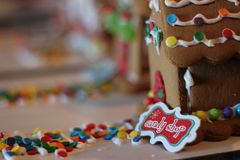 Holiday Candy Shop Gingerbread House. Closeup with houses in a row in background stock photo