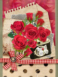 Holiday card with bouquet of beautiful roses on old paper background. Stock Photos