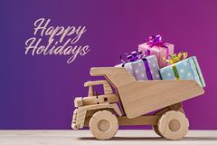 Happy Holidays. Toy dump truck with gifts. stock photos