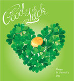 Holiday card with calligraphic words Good Luck and Shamrock hear. T with golden coin on green background Stock Photos