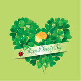 Holiday card with calligraphic words Happy St. Patricks Day. And Shamrock heart with golden coin on green background Stock Photo