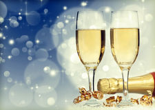 Holiday card with champagne and festive lights Royalty Free Stock Images