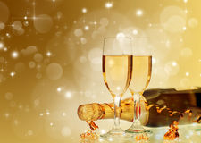 Holiday card with champagne and festive lights Stock Photo