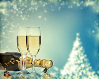 Holiday card with champagne and festive lights Stock Images