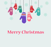 Holiday card design with knitted mittens Royalty Free Stock Photo