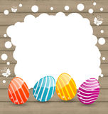 Holiday card with Easter colorful eggs on wooden background Stock Photo