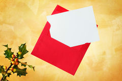 Holiday card and envelope. Holiday card an envelope on a hand painted gold background Royalty Free Stock Photo