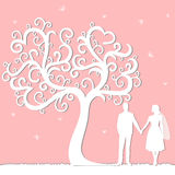 Holiday card with the newlyweds. Wedding card with the newlyweds on a pink background with decorative tree. Bride and groom Royalty Free Stock Photography