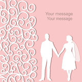 Holiday card with the newlyweds. Wedding card with the newlyweds on a pink background with ornament and place for text. Bride and groom. Also suitable for Stock Images
