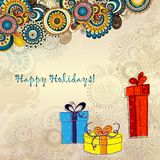Holiday card with three gift boxes with bows. On the doodle floral background. Sketch style Stock Photography