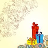 Holiday card with three gift boxes with bows. On the doodle floral background. Sketch style Stock Photos