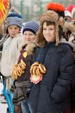 Holiday maslenitsa. Winter snow. Children with donuts. royalty free stock photography