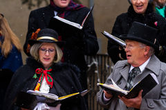 Holiday carolers Stock Photo
