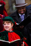 Holiday carolers Stock Images