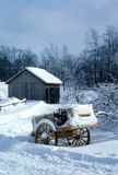 Holiday cart. A wagon from the previous harvest sits snow covered Stock Photo