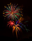 Holiday Celebration Fireworks Display. Exploding fireworks dazzle spectators during a national holiday Royalty Free Stock Image