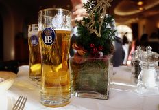 Holiday celebration with HB Bavarian beer. Holiday decorated table and two glass of Bavarian HB famous beer Royalty Free Stock Image