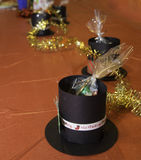 Holiday Celebration. Table decorations including top hat, sweet treats, and garland Royalty Free Stock Image